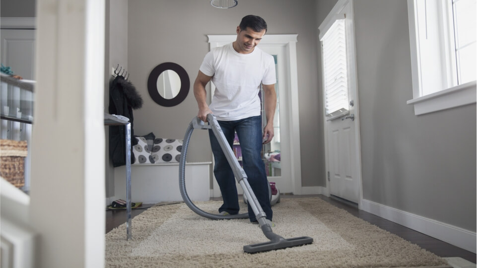 Professional Carpet cleaning in a living room by professional upholstery cleaner. Carpet cleaners for hire Oxford and Abingdon.